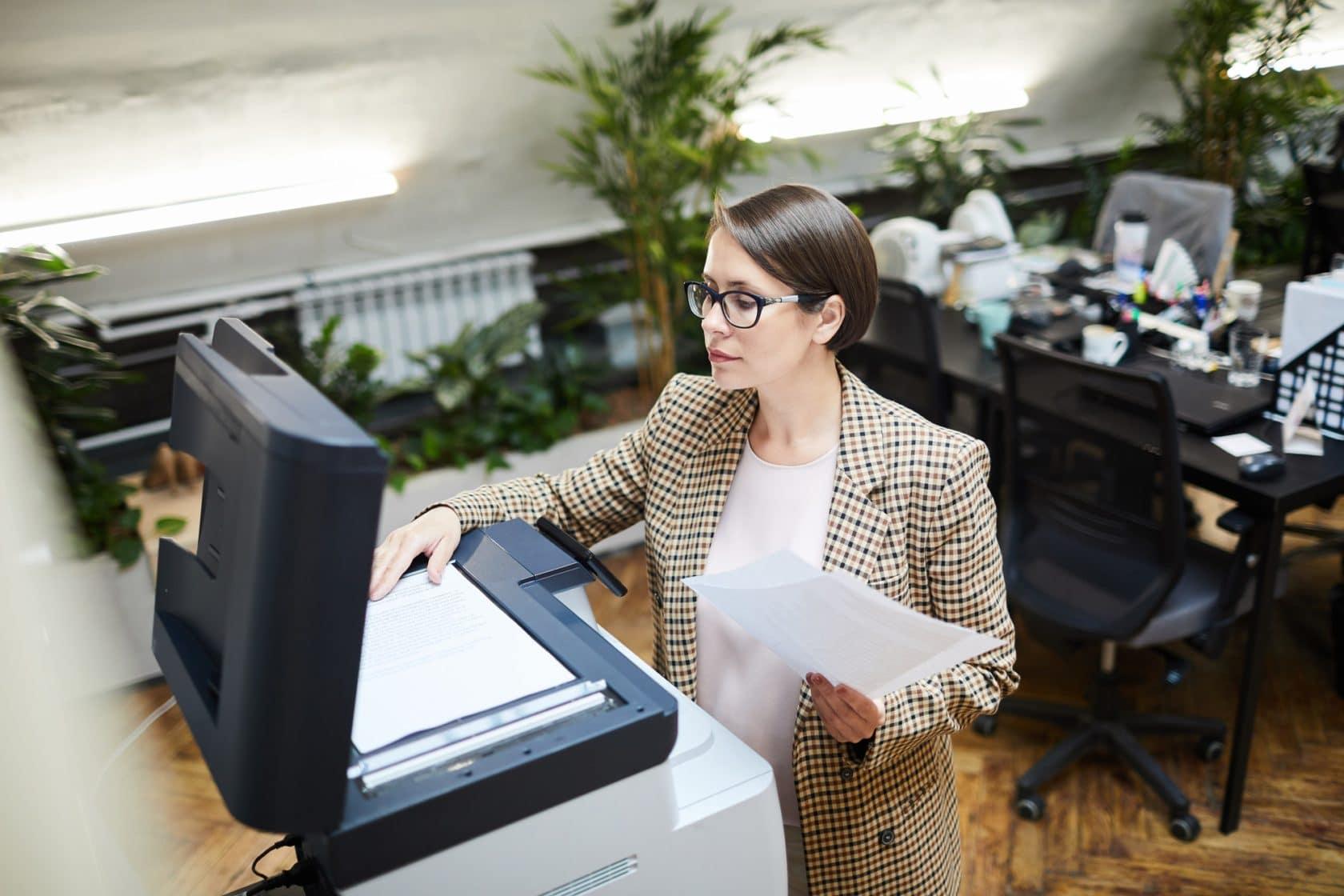 Businesswoman Scanning Documents