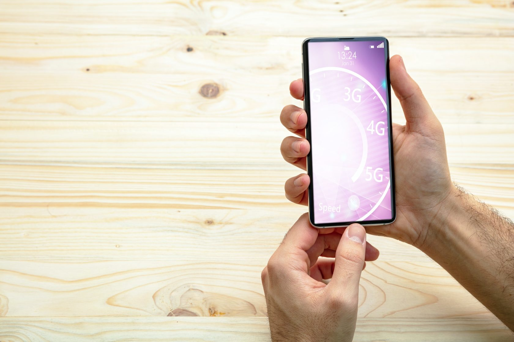 Man holding a smartphone, internet speed test on the screen, wooden background, copy space
