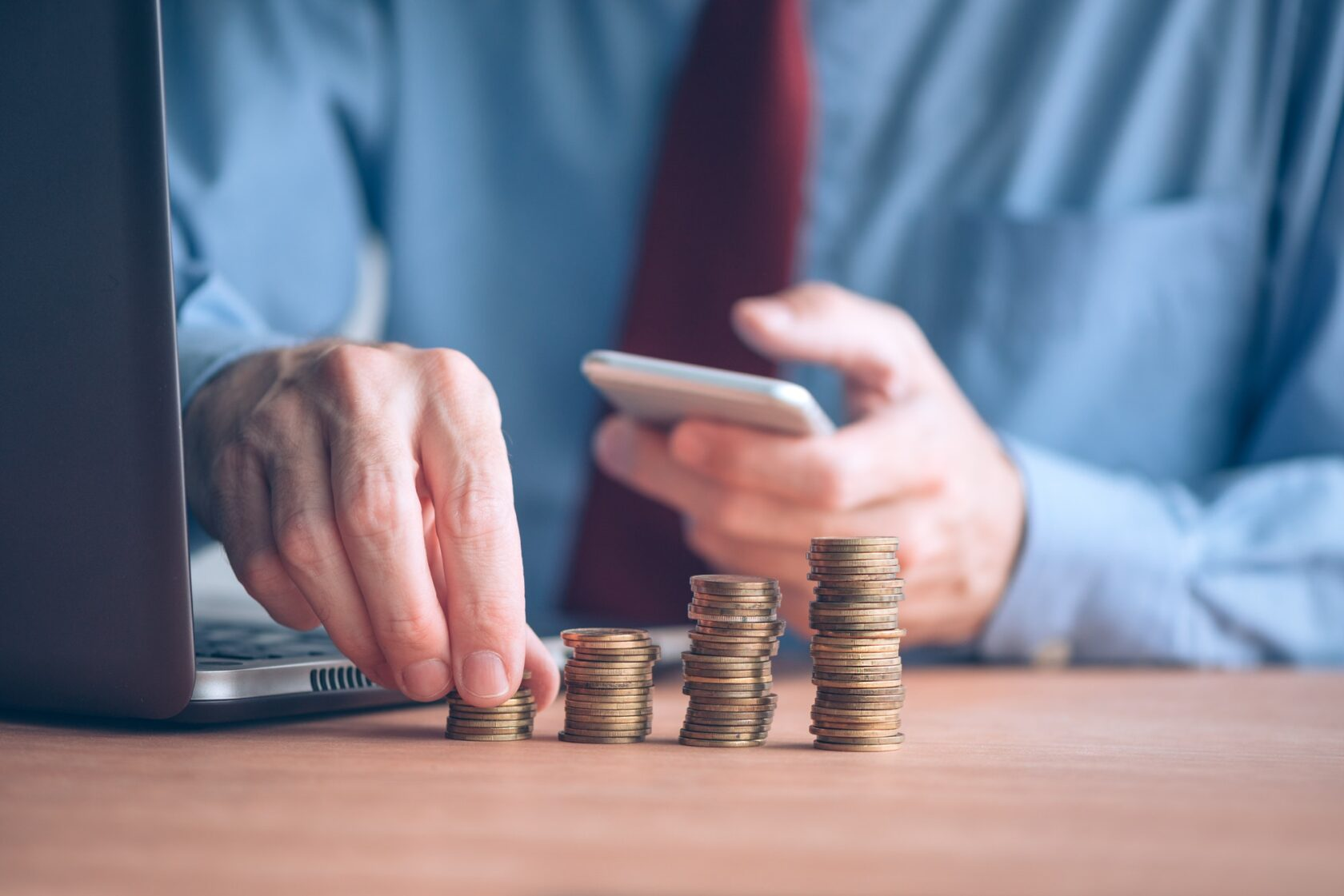 Finances and budgeting, businessman stacking coins