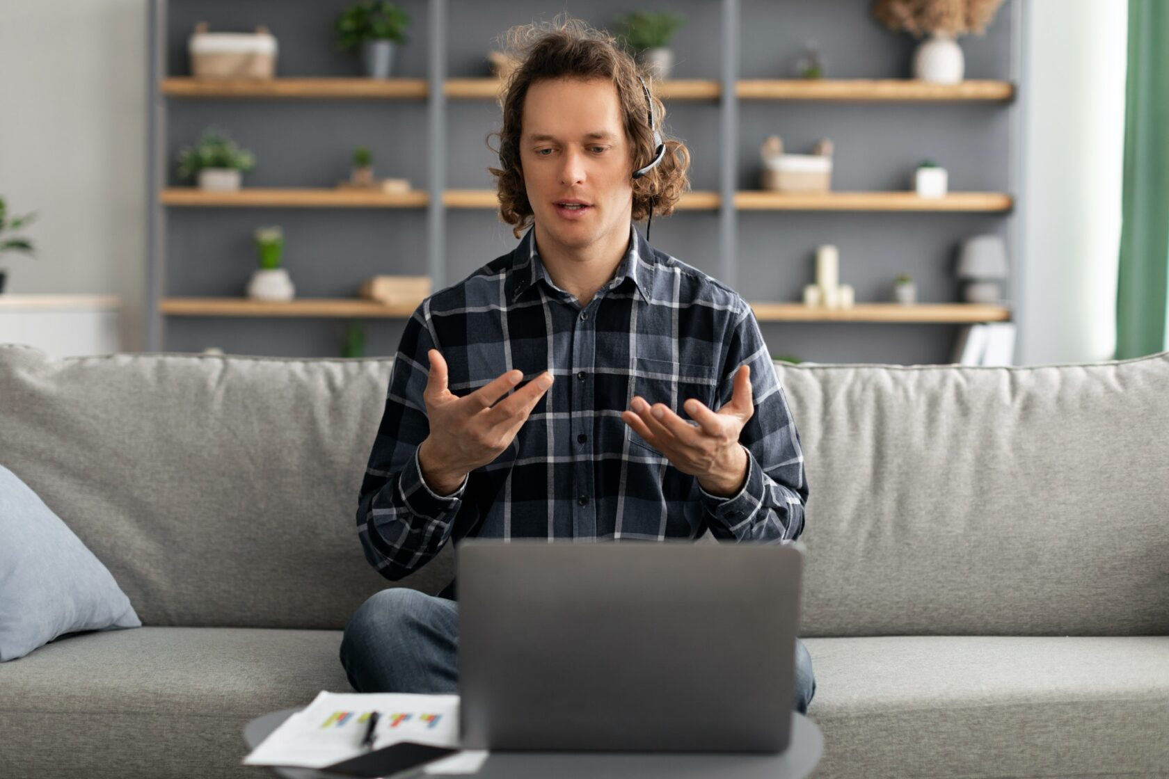 Man Video Calling At Laptop Having Virtual Meeting At Home